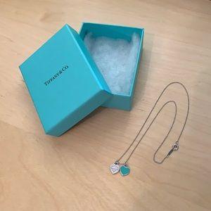 Tiffany & Co. Double Heart Tag Pendant.